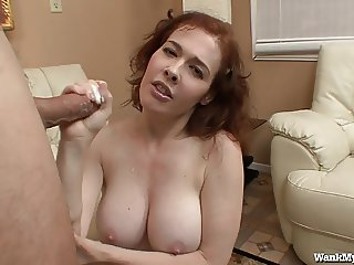 Redhead MILF Gives Great Handjobs!