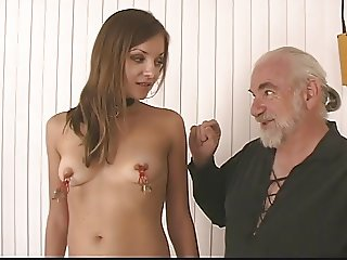 Young brunette bdsm girl with perfect tits, ass, and shaved pussy is restrained