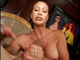 Latina whore jerks guy off while smoking