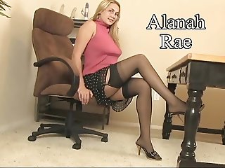 Cute young blonde rides a big dildo by her pussy on her desk