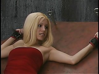Ponytailed dude attaches clamps to captured blonde's hard nipples