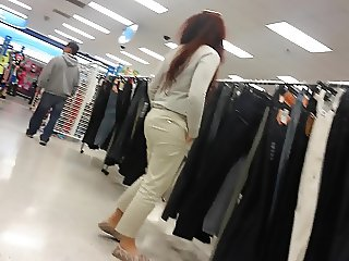 Pulling pants on that ass