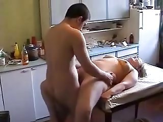 Busty mature with young guy in the kichen