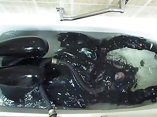 Rubber girl in the bath