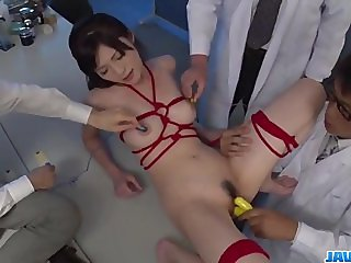 Sara Yurikawa stimulated in kinky bondage