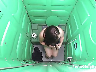 Porta Gloryhole girl gets naked in Public Porta Potty
