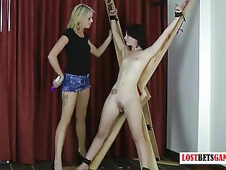 2 beautiful girls play a game of strip darts