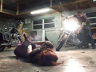 Biker girl hogtied in the garage
