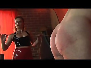 Mistress spanking, and using cane on her slave