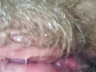 Licking her hairy wet granny pussy