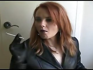 Smoking redhead in leather