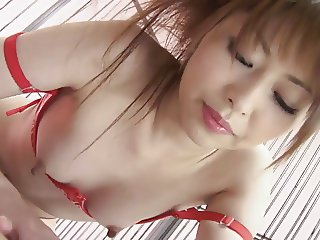 Girl in red latex and stockings gets hardcore fuck in bed