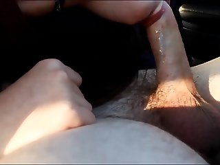 Hot brunette babe gives car blowjob and swallows cum