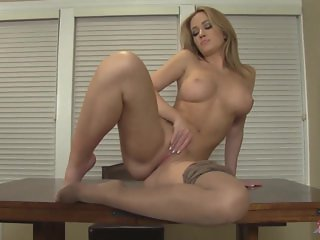 Hot blonde Angela in pantyhose strips to masturbate