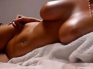Babe with big oiled boobs tits and shaved pussy