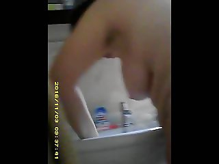 Mature wife hangs tits and belly at sink