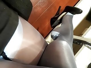 Kinky office milf teasing in nylon stockings and high heels