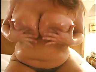 Chubby Blonde Playing with Massive Boobs