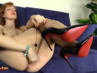 Footjob by a redhead wearing only tan pantyhose