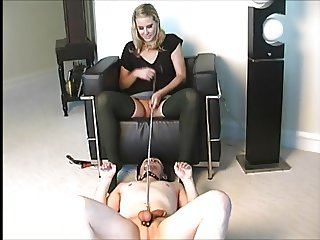 She humiliates and uses him as an Asslicker