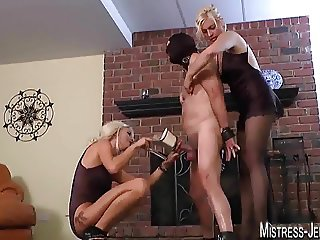 Two blonde Femdom Mistresses set a cock on fire