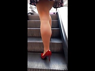 #10 Woman with sexy legs in pantyhose and red high heels