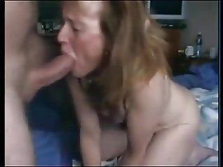 Mature wife sucks big dick on the camera.