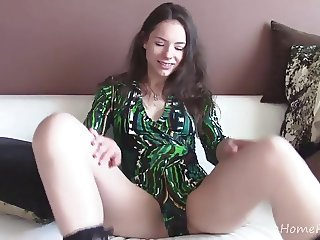 Hottie puts on sexy socks before masturbating