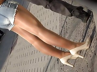 candid in shiny tan pantyhose
