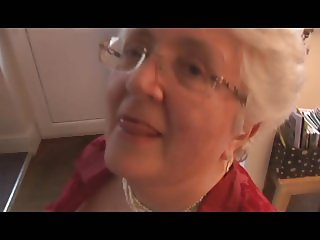 Granny with massive boobs stripping and spreading