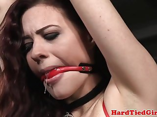 BDSM sub canned while tied up with rope