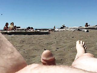 Guy with tiny dick exposes him to girls on the beach