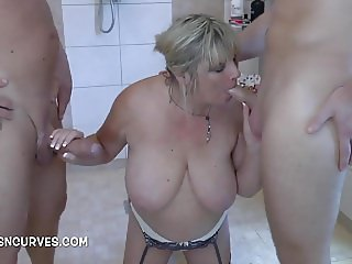 Mature housewife deep throating two men
