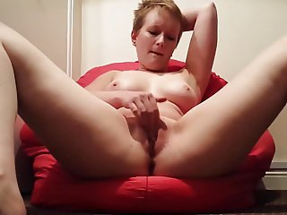 Short haired British girl legs spread, dildo inserted.