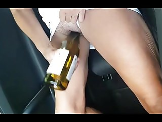 Wife cums in car frigging bottle
