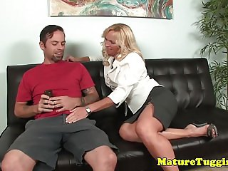 Bigtitted glamour milf tugging dick on couch
