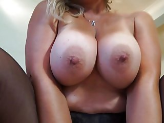 Gorgeous mature babe with big boobs stripping