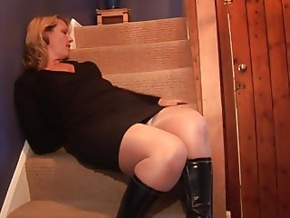 Mature blonde babe upskirt no panties on the stairs
