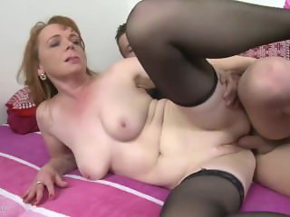 Big titted brunette mature fucks in stockings