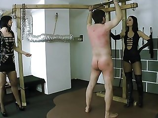 Two young ladies whipping male slave 02
