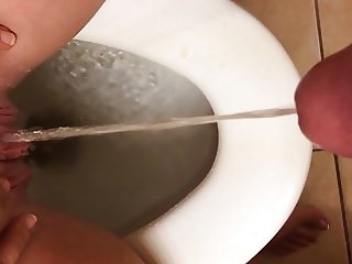 Pissing on my clit