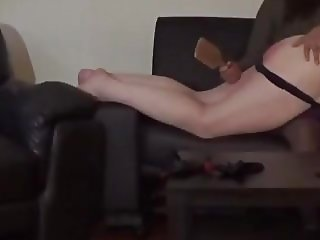 Aunty Belle spanks her naughty nephew with a hairbrush.