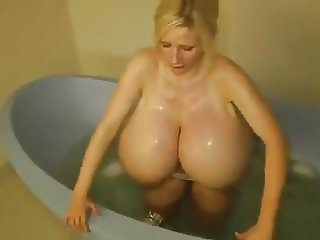 Monster fake boobs in bathtub