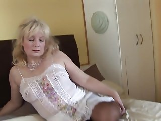 Busty mature blonde in sheer pantyhose slip and stockings