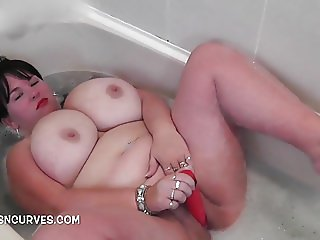 Busty Babe in the piss bath