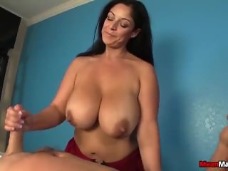 Busty mature lady jerks off a dick