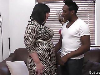 Big tits woman in fishnets rides black cock