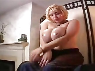 Oiling her huge tits
