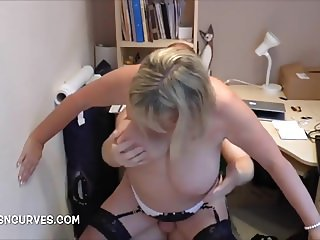 A secretary makes it up to her boss