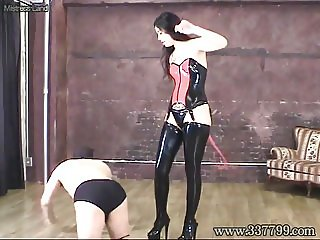 Domina training a slave with a whip and face sitting